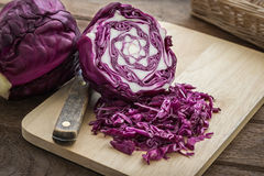 Red cabbage sliced on wooden cutting board Royalty Free Stock Images