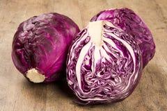 Red cabbage on a wood. Repolho roxo em uma madeira stock image