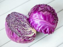 Red cabbage on a wooden table Stock Images