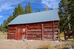 Red Cabin in Autumn Stock Images