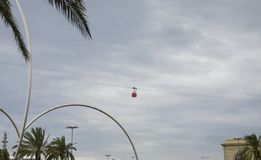 Red cabin on cableway. Red cable car in the sky of Barcelona, Spain. stock photos