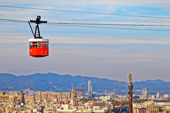 Red cabin of cableway stands out Barcelona Stock Photography