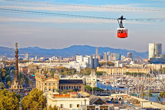Red cabin of cableway stands out on Barcelona's port Royalty Free Stock Photo