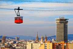 Red cabin of cableway stands out on the skyline of Barcelona Stock Image