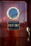 Red cabin door mahogany. Ship with portholes Stock Photography