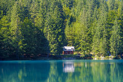 Red cabin. On the lake Royalty Free Stock Image