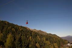 Red cabin over mountain Stock Photos