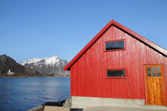 Red cabin and Stamsunds Church Stock Photo