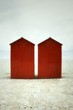 Red cabins and sea Royalty Free Stock Photography