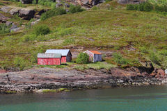 Red cabins  on the  shores  of  Birds island Royalty Free Stock Images