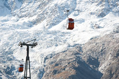 Red cabins on ski lift Stock Photos