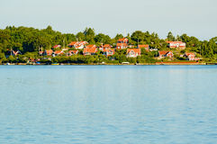 Red cabins by the water Stock Photography