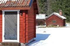 Red cabins in winter. Two red, wooden cabins in winter Stock Photography