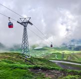 Red cable cabin down from Mannlichen with scenic view in direction to Grindelwald, Switzerland, Europe Stock Photo