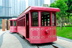Red Cable Car. Two red cable cars parking at rail with buildings in background.Taken in Rongqiao Park, Chongqing, China Royalty Free Stock Image