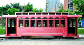 Red Cable Car. A red cable car parking at rail with buildings in background.Taken in Rongqiao Park, Chongqing, China Stock Photo