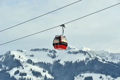 Red cable car in Alps. Kitzbuhel Austria in December 2011. Cable cars take tourits to the ski slope Royalty Free Stock Photography