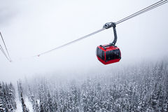 Red Cable Car on White. Red Gondola Cable Car Ski Lift White Foggy Conditions Stock Photos