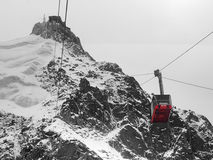 Red cable car in high mountains Stock Images