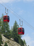 Red cable car lift Stock Images