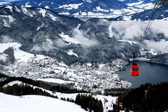 Red cable car over Wolfgangsee in winter, St Wolfgang, Austria.  Royalty Free Stock Photography