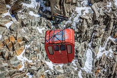 Red cable car railway, cableway, in ski resort Royalty Free Stock Photo