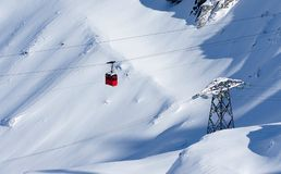 Red cable car in winter alpine landscape stock photography