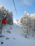 Red cable car in winter in the Alps Royalty Free Stock Photography