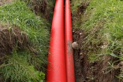 Red cable pipes Stock Image