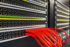 Red cables connected to the phone and internet line Royalty Free Stock Photo