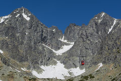 Red cableway rising to the top in High Tatras Stock Photo