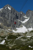 Red cableway rising to the top in High Tatras Royalty Free Stock Photography