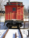 Red Caboose. Little red caboose in winter setting. Bright repainting shows the railroad car in high decoration Royalty Free Stock Image