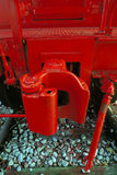 Red Caboose Coupling. A coupling on a caboose painted bright red Stock Photo