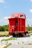 Red Caboose Under Blue Sky Royalty Free Stock Photo