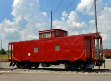 Free Red Caboose Under Sunny Skies Royalty Free Stock Image - 108968326