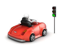 Red cabrio starting on green traffic light signal Royalty Free Stock Images