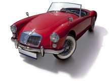 Red cabriolet. Car styled in early 1960s. Retouched photo, isolated with clipping path Stock Photos
