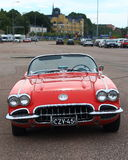 Red cabriolet on parking in cloudy day. Old Chevrolet Corvette in the parking lot. Front view. Kotka, Finland Royalty Free Stock Photo