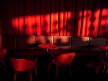 Red cafe. Sun light in interior royalty free stock photos