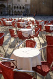 Red cafe chairs and tables in morning sun, Venice, Royalty Free Stock Photos