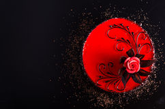 Red Cake with rose on black background. Top view. Valentine`s Day. Free space for your text. Royalty Free Stock Image
