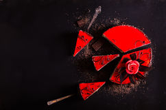 Red Cake with rose on black background. Top view. Valentine`s Day. Free space for your text. Stock Photo