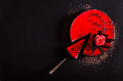 Red Cake with rose on black background. Top view. Valentine`s Day. Free space for your text. Royalty Free Stock Photography