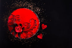 Red Cake with rose, two hearts on black background. Top view. Valentine`s Day. Free space for your text. Stock Image