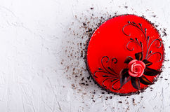 Red Cake with rose on white concrete background. Top view. Valentine`s Day. Free space for your text. Stock Photos