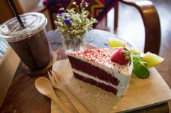 Red  cake on wood board stock photos