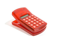 Red calculator and clip in one Stock Image