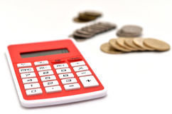 Red Calculator and japanese coin Royalty Free Stock Photo