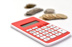 Red Calculator and japanese coin Stock Photos